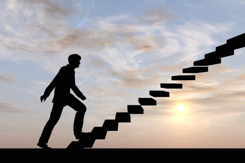 strategic recruiting conceptual 3D male businessman on stair or steps over sunset sky background, metaphor to success, climb, business, rise, achievement, growth, job, career, leadership, education, goal or future